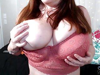 Chubby mature flashes the huge jugs while preparing to masturbate