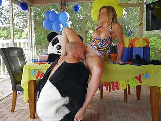 Busty mom gets intimate with the guy in the Panda suit